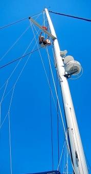 Me climbing the mast